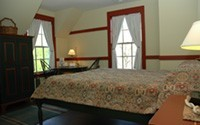 Room 302 has a queen sized bed and a set of bunk beds.  This unique room is named for one of our local artists, Fredrick Polley.