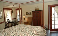 The Ada Schultz room has one queen sized bed and a large private balcony overlooking the main thoroughfare through downtown Nashville.