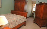 The Walter Griffith suite offers a cozy bedroom with one queen sized sleigh bed, a living room which has a sleeper sofa, a kitchenette with a microwave oven, a small refrigerator and a wet bar and a Jacuzzi tub.  Enjoy TV viewing in the living room or the bedroom.