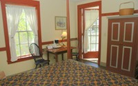 Enjoy the Artists Colony Inn while staying in Carl Graf's room 207.  It is furnished with a queen sized bed and a courtyard balcony.